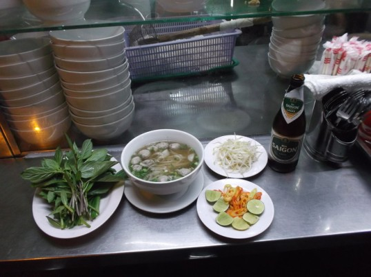 The quintessential meal here: phở.  With a Saigon beer, of course.