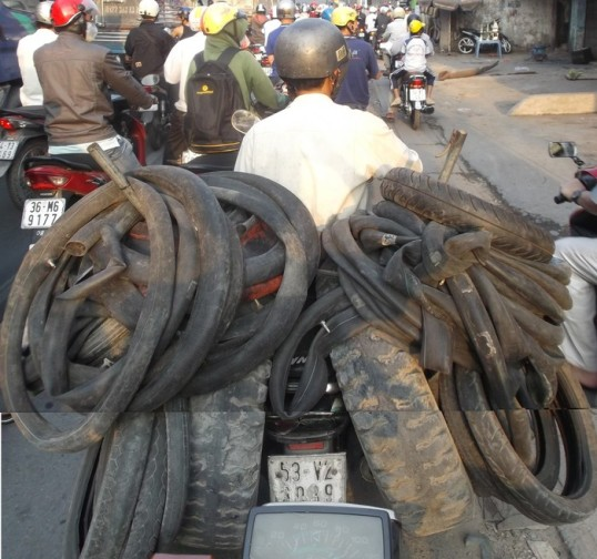 """In Vietnam, there's no effective difference between """"motorcyle"""", """"18 wheeler"""" or """"general cargo transport"""".  It's common to see anything....ANYTHING...being hauled by motorbike.  A slaughtered pig?   A family of 5?  Easy. Another motorcycle?  A couple dozen chickens?  No problem."""