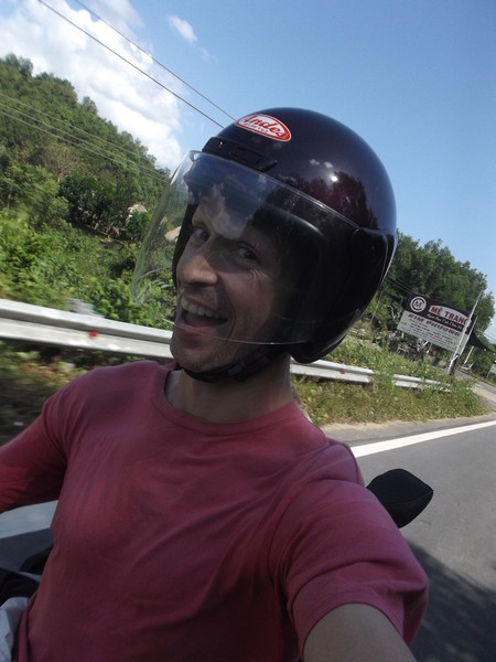 I'm probably explaining why I thought it was ok to be taking a selfie ...while riding a motorcycle...in a t-shirt and shorts.  'Cause, y'know, physics is different in Vietnam.