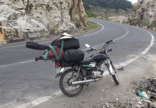 My ride for a month, taking a break on a mountain road near Da Lat.
