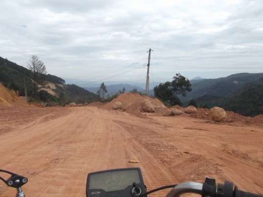 Riding down a highway under construction, north of Da Lat.